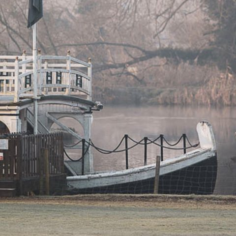 A private jetty with boat moored at Oxford Thames