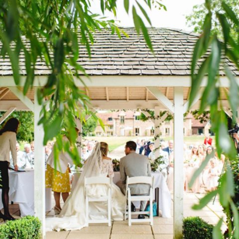 Marry outdoors under our canopy next to the river