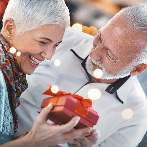 A couple giving gifts at Christmas